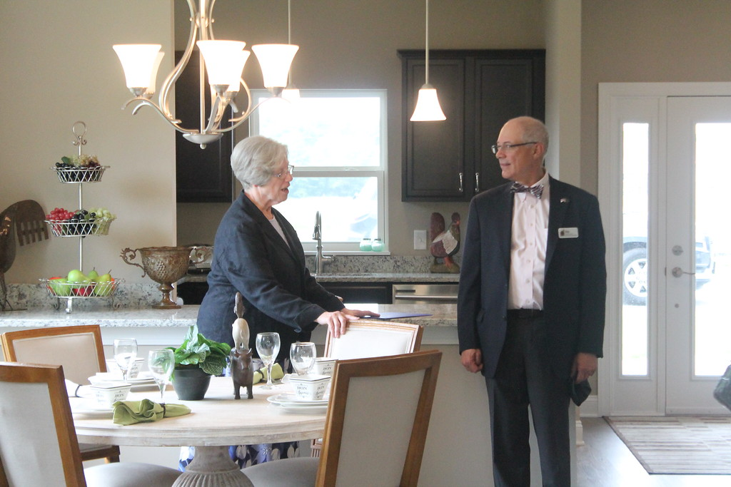 . Sister Margaret Gorman, Provincial Superior, Sisters of Notre Dame speaks to Geauga County Commissioner Walter Claypool in one of the model cottages at the newly constructed Notre Dame Village during a media tour on Aug. 20.