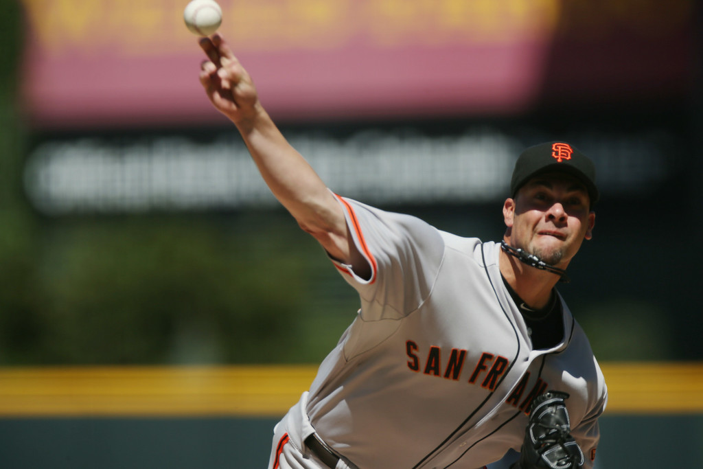 . San Francisco Giants starting pitcher Ryan Vogelsong works against the Colorado Rockies in the first inning of a baseball game in Denver on Wednesday, Sept. 3, 2014. (AP Photo/David Zalubowski)