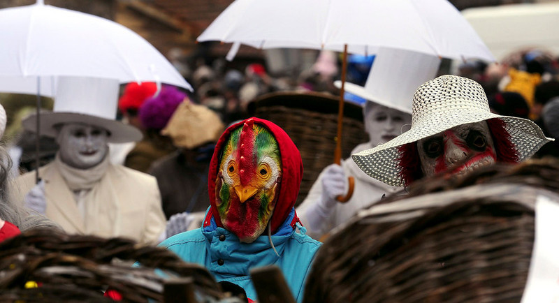 . Masked villagers, during the carnival, in Vevcani, a small village in southwestern Macedonia, on Sunday, Jan. 13, 2013. The festivities have been held on St. Vasilij\'s day for more than fourteen centuries, marking the arrival of the New Year by the Julian calendar. The carnival which has pagan roots, highlight political satire, with masked local people acting out the current events. (AP Photo/Boris Grdanoski)
