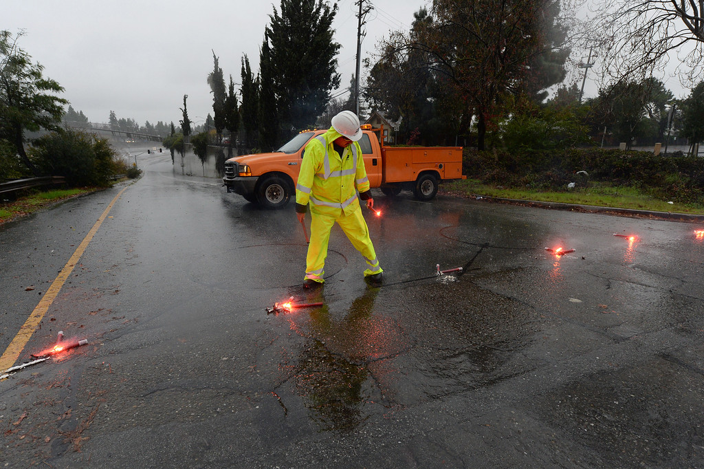. CalTrans crews close the onramp to Interstate 680 southbound at Moorpark due to flooding in San Jose, Calif., on Thursday, Dec. 11, 2014. The big storm made it way south, after pounding the North Bay in the early morning hours. (Dan Honda/Bay Area News Group)