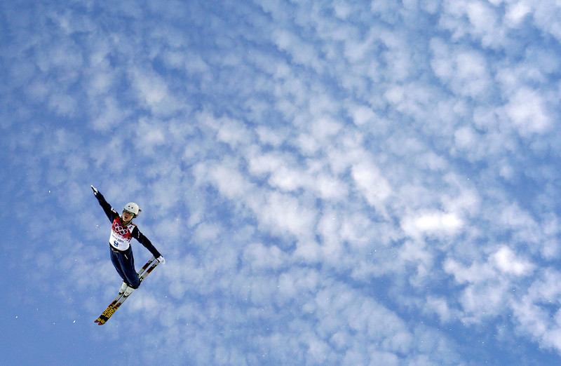 . Ashley Caldwell of the United States jumps during women\'s freestyle skiing aerials training at the Rosa Khutor Extreme Park, at the 2014 Winter Olympics, Friday, Feb. 14, 2014, in Krasnaya Polyana, Russia. (AP Photo/Patrick Semansky)