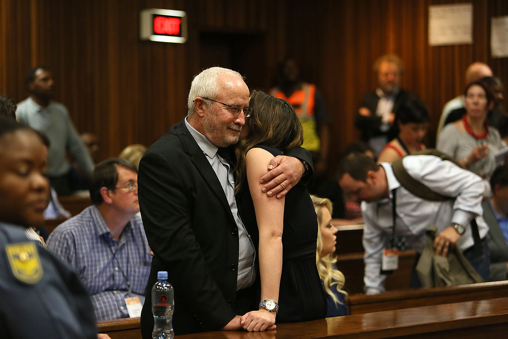 . Henke, father of Oscar Pistorius,  hugs Aimee Pistorius during a break in proceedings in the judgment in his murder trial at the High Court in Pretoria on  September 12, 2014. South African Judge Thokozile Masipa on Friday extended Oscar Pistorius\'s bail and set a date of October 13 for sentencing on a charge of culpable homicide. Alon Skuy/PoolAlon Skuy/AFP/Getty Images
