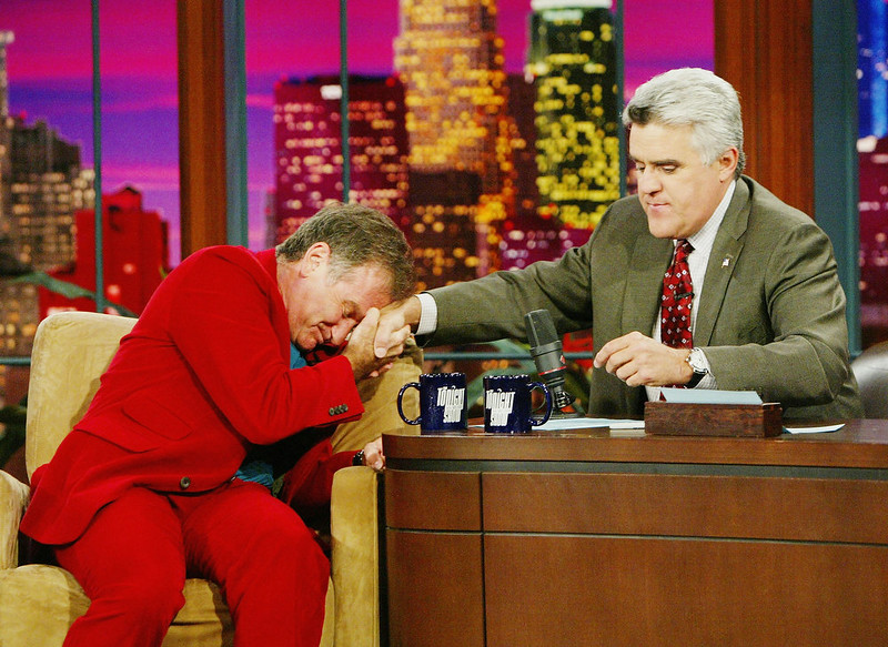 ". Comedian/actor Robin Williams (L) appears on ""The Tonight Show with Jay Leno\"" at the NBC Studios on October 14, 2004 in Burbank, California.  (Photo by Kevin Winter/Getty Images)"