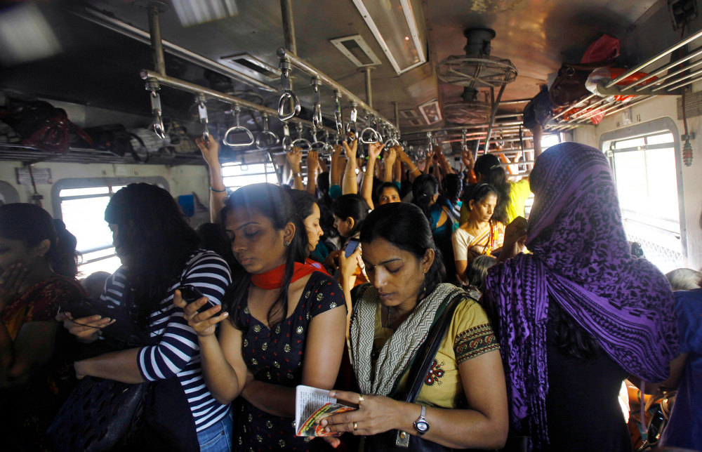 . Indian women travel in the women\'s compartment of a train early morning in Mumbai, India, Thursday, Jan. 10, 2013. Five men have been charged with attacking the 23-year-old woman and a male friend on a bus as it was driven through the streets of India\'s capital. The woman was raped and assaulted with a metal bar on Dec. 16, 2012 and eventually died of her injuries. The case has sparked protests across India by women and men who say India\'s legal system doesn\'t do enough to prevent attacks on women. (AP Photo/Rafiq Maqbool)