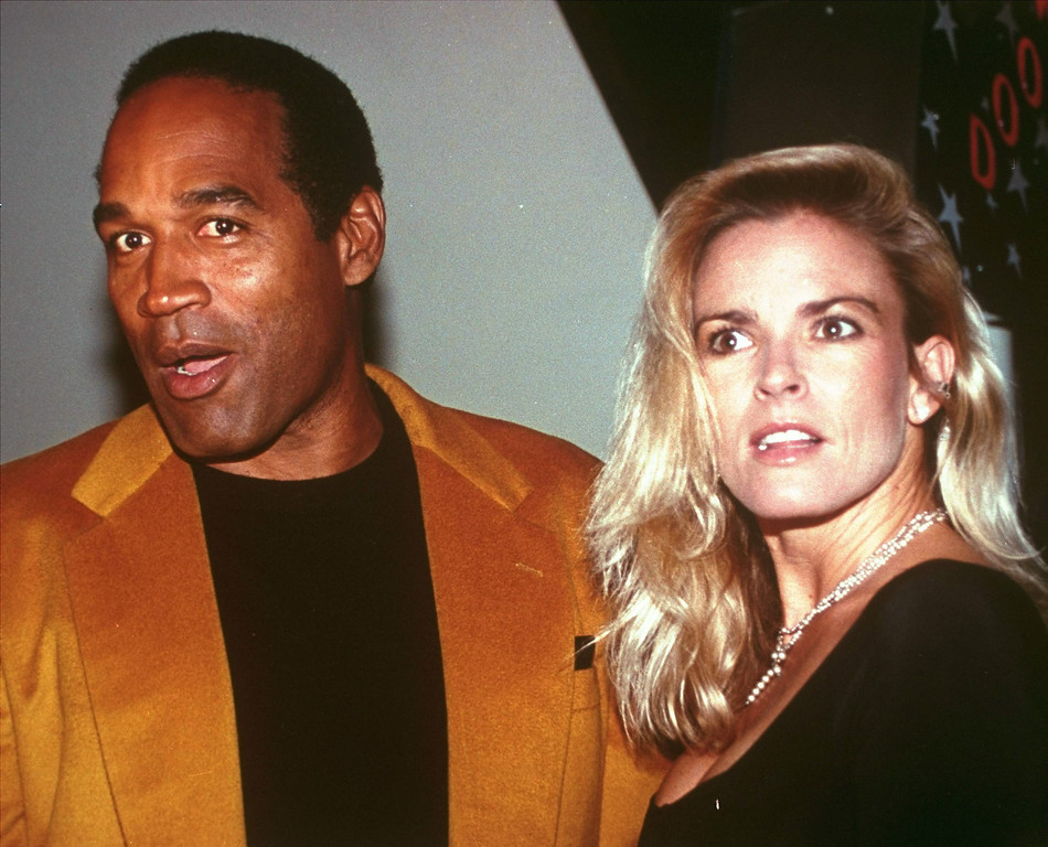 """. O.J. Simpson and his wife, Nicole Brown Simpson, celebrate the opening of the Harley-Davidson Cafe in this Oct. 19, 1993 file photo. O.J. Simpson created an uproar Wednesday, Nov. 15, 2006 with plans for a TV interview and book titled \""""If I Did It\"""".  Fox, which plans to air an interview with Simpson Nov. 27 and 29, said Simpson describes how he would have committed the 1994 slayings of his ex-wife, Nicole Brown Simpson, and her friend Ronald Goldman, \""""if he were the one responsible.\"""" (AP Photo/Paul Hurschmann)"""