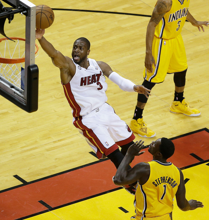 . Miami Heat shooting guard Dwyane Wade (3) heads to the basket as Indiana Pacers shooting guard Lance Stephenson (1) looks on during the first half of Game 7 in their NBA basketball Eastern Conference finals playoff series, Monday, June 3, 2013 in Miami. (AP Photo/Wilfredo Lee)