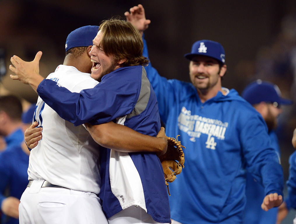 . The Dodgers\' Kenley Jansen hugs Clayton Kershaw after the final out against  the Atlanta Braves during game 4 of the NLDS at Dodger Stadium Monday, October 7, 2013. The Dodgers beat the Braves 4-3.(Photo by Hans Gutknecht/Los Angeles Daily News)