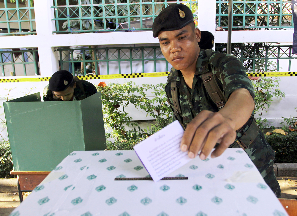 . A Thai soldier casts his vote during the general election at a polling station in Bangkok, Thailand Sunday, Feb. 2, 2014.  (AP Photo/Apichart Weerawong)