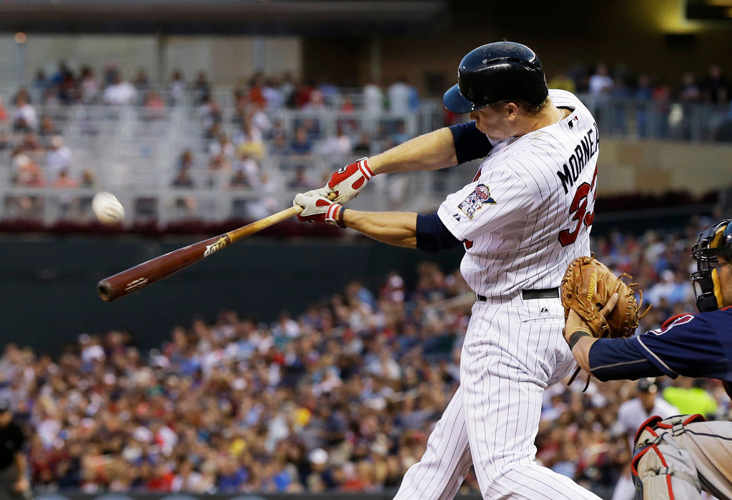 . Minnesota Twins\' Justin Morneau flies out in the fourth inning. (AP Photo/Jim Mone)