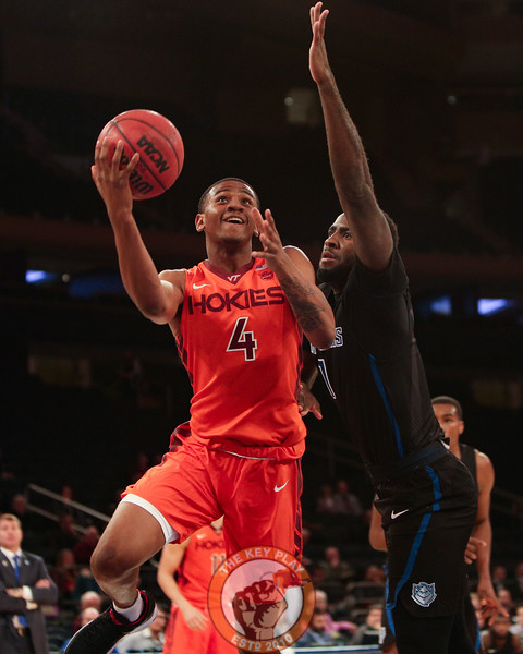 Virginia Tech's guard Nickeil Alexander-Walker (4) drives against a St. Louis defender in Madison Square Garde, Nov. 16, 2017. St. Louis upset Virginia Tech with a 77-71 win.