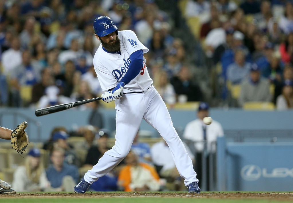 . Scott Van  Slyke #33 of the Los Angeles Dodgers hits an RBI single in the fifth inning against the Colorado Rockies at Dodger Stadium on September 27, 2014 in Los Angeles, California.  (Photo by Stephen Dunn/Getty Images)