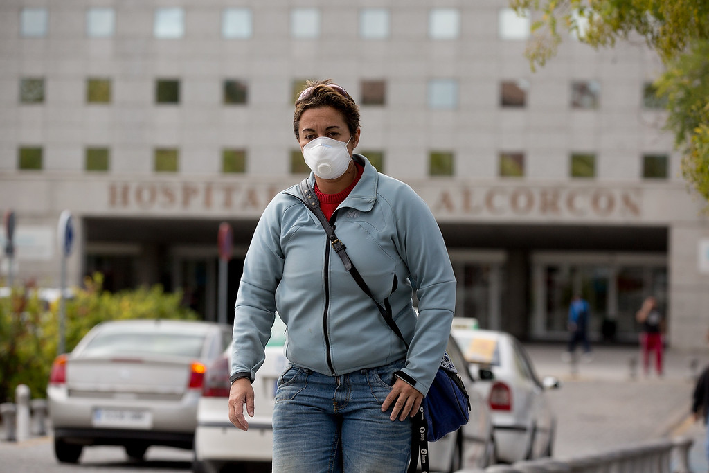 . A woman wears protective mask as she leaves Hospital Fundacion Alcorcon where a Spanish nurse tested positive for the Ebola virus on October 7, 2014 in Alcorcon, near Madrid, Spain.   (Photo by Pablo Blazquez Dominguez/Getty Images)
