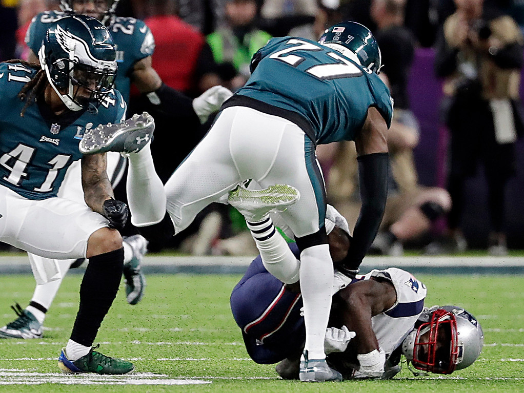 . New England Patriots wide receiver Brandin Cooks (14), falls after colliding with Philadelphia Eagles strong safety Malcolm Jenkins (27), during the first half of the NFL Super Bowl 52 football game, Sunday, Feb. 4, 2018, in Minneapolis. To the left is Philadelphia Eagles cornerback Ronald Darby (41). (AP Photo/Tony Gutierrez)