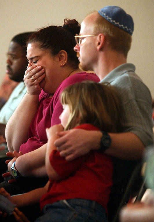 . Linda Tyndall of Melbourne, Florida sobs during the space shuttle Columbia astronauts memorial prayer service at Temple Beth Sholom while sitting with her husband Bob Tyndall and daughter Rebecca Tyndall on Sunday, February 2, 2003. The Tyndalls had met with Isreali astronaut  Ilan Ramon at the temple before the ill fated flight. The Tyndalls had also taken exchange students they were hosting to see the launch of Columbia on January 16, 2003. CYRUS MCCRIMMON, The Denver Post