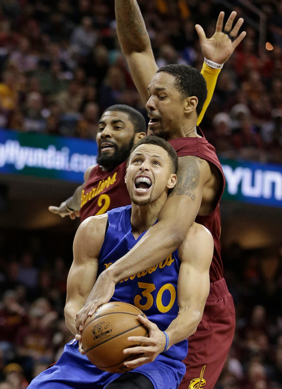 . From foreground, Golden State Warriors\' Stephen Curry is fouled by Cleveland Cavaliers\' Channing Frye as Kyrie Irving defends in the second half of an NBA basketball game, Sunday, Dec. 25, 2016, in Cleveland. The Cavaliers won 109-108. (AP Photo/Tony Dejak)