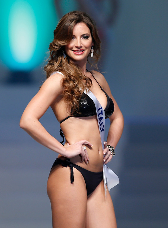 . Miss Italy Sara Caragnani smiles in the swimsuit competition during the final of the 53rd Miss International Beauty Pageant in Tokyo Tuesday, Dec. 17, 2013. (AP Photo/Shizuo Kambayashi)