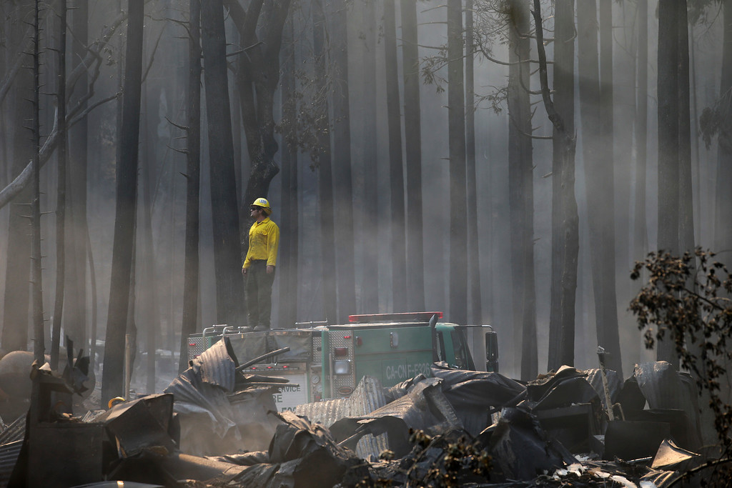. A firefighter stands on top of a fire truck at a campground destroyed by the Rim Fire near Yosemite National Park, Calif., on Monday, Aug. 26, 2013. Crews working to contain one of California\'s largest-ever wildfires gained some ground Monday against the flames threatening San Francisco\'s water supply, several towns near Yosemite National Park and historic giant sequoias. (AP Photo/Jae C. Hong)
