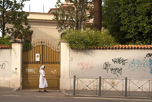 A nun walking outside the Vatican.