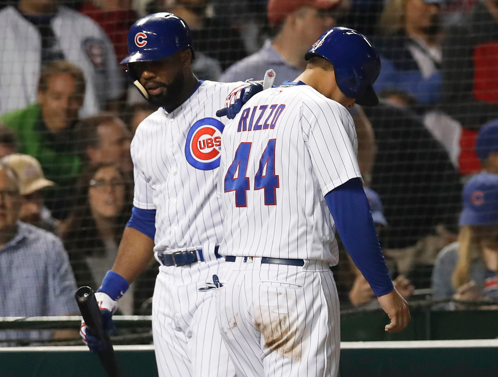 . Chicago Cubs\' Anthony Rizzo, right, is consoled by Jason Heyward as he walks back to the dugout after being tagged out at home during the seventh inning of the team\'s baseball game against the Cleveland Indians on Wednesday, May 23, 2018, in Chicago. (AP Photo/Jim Young)