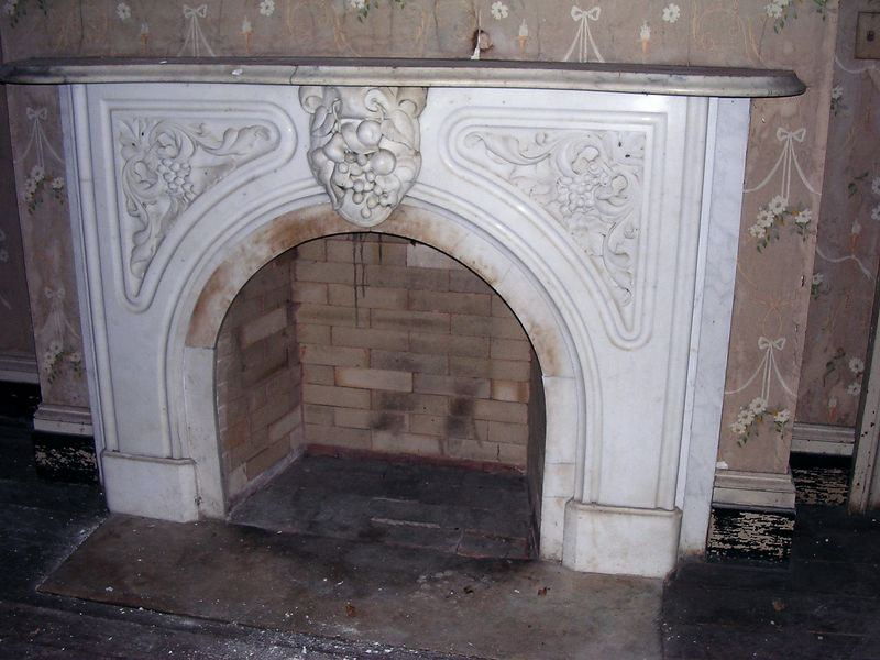 The white marble fireplaces in the main parlors are ornately sculpted.