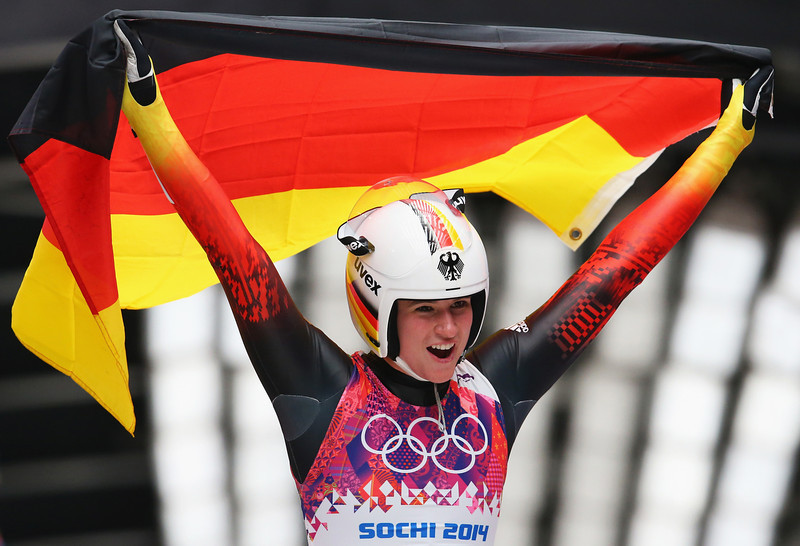 . Natalie Geisenberger of Germany celebrates winning gold medal after the Women\'s Luge Singles on Day 4 of the Sochi 2014 Winter Olympics at Sliding Center Sanki on February 11, 2014 in Sochi, Russia.  (Photo by Alex Livesey/Getty Images)