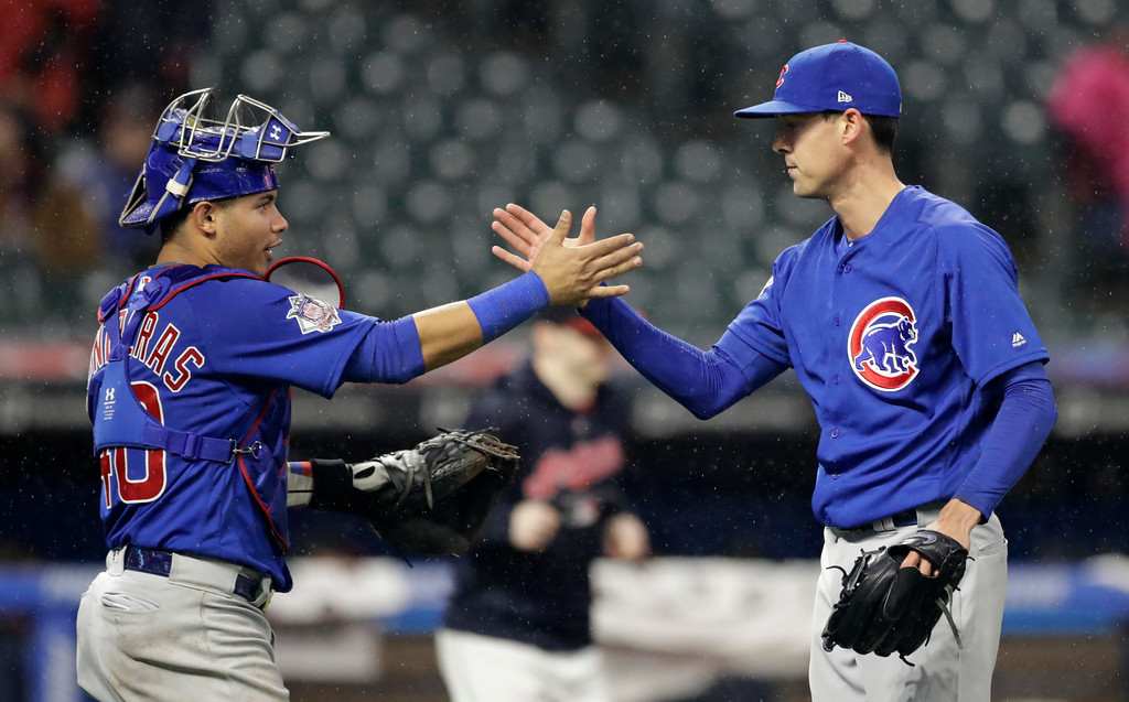 . Chicago Cubs relief pitcher Luke Farrell, right, is congratulated by catcher Willson Contreras after the Cubs defeated the Cleveland Indians 10-3 in a baseball game, Tuesday, April 24, 2018, in Cleveland. (AP Photo/Tony Dejak)