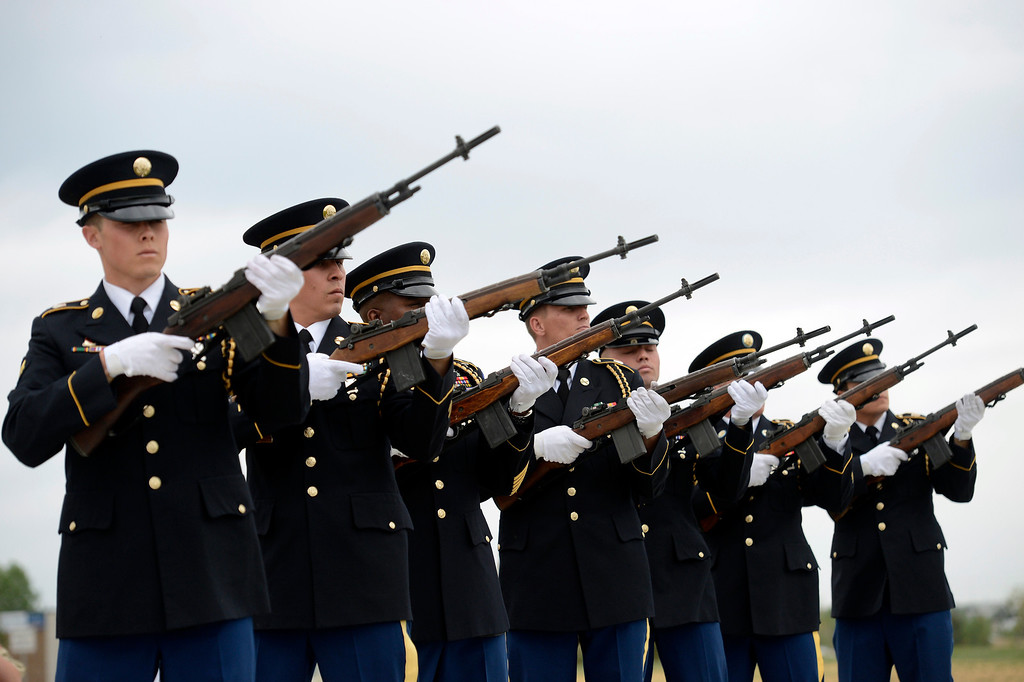 . Firing party - Buckley Air Force Base Honor Guard, fire their weapons during the Colorado Freedom Memorial dedication May 26, 2013 in Aurora.  (Photo By John Leyba/The Denver Post)