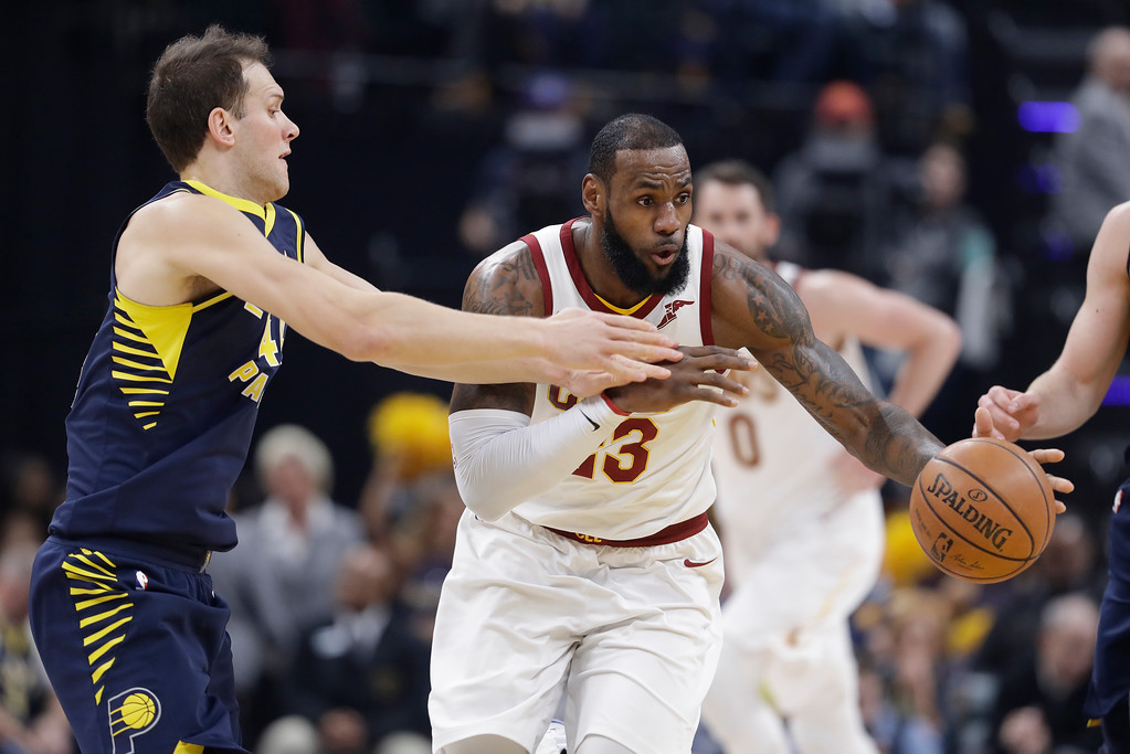 . Cleveland Cavaliers\' LeBron James dribbles past Indiana Pacers\' Bojan Bogdanovic, left, during the first half of an NBA basketball game, Friday, Jan. 12, 2018, in Indianapolis. (AP Photo/Darron Cummings)