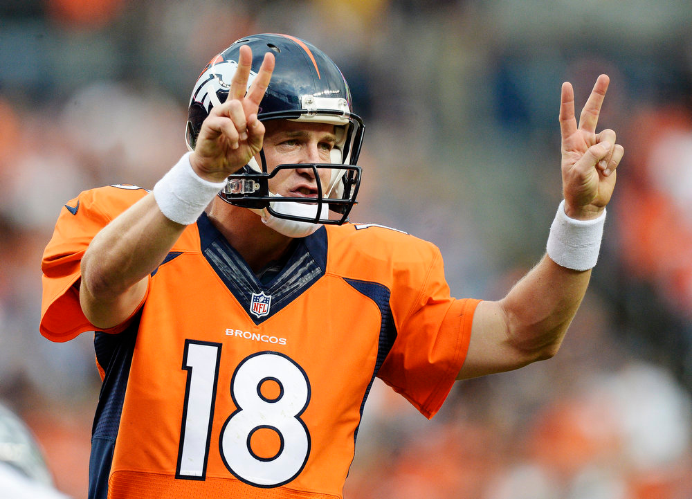 . Denver Broncos quarterback Peyton Manning (18) signals out during the first quarter against the Seattle Seahawks August 7, 2014 at Sports Authority Field at Mile High Stadium.  (Photo by John Leyba/The Denver Post)