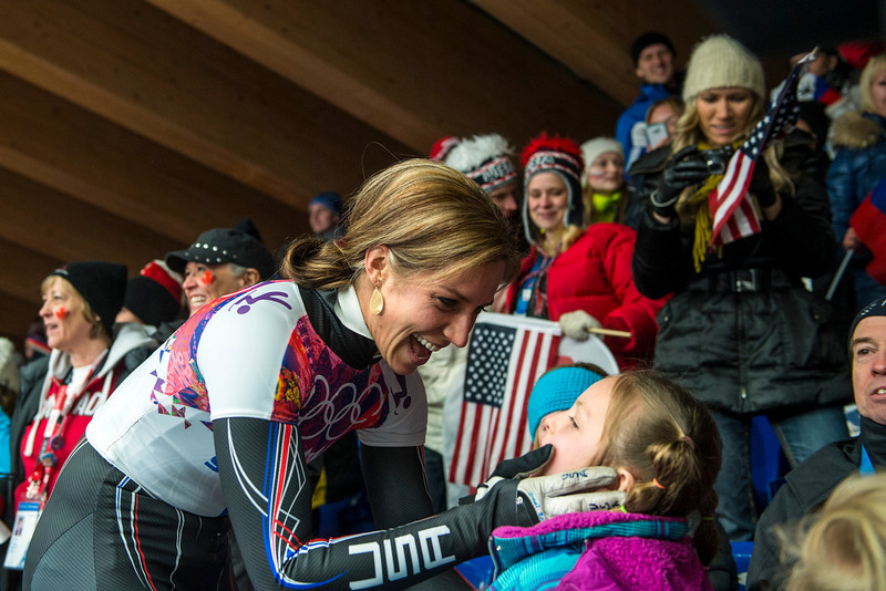 . Noelle Pikus-Pace celebrates with her daughter Lacee, 6, after winning the silver medal in the women\'s skeleton competition at Sanki Sliding Center during the 2014 Sochi Olympics Friday February 14, 2014. Pikus-Pace finished with a time of 3:53.86. (Photo by Chris Detrick/The Salt Lake Tribune)