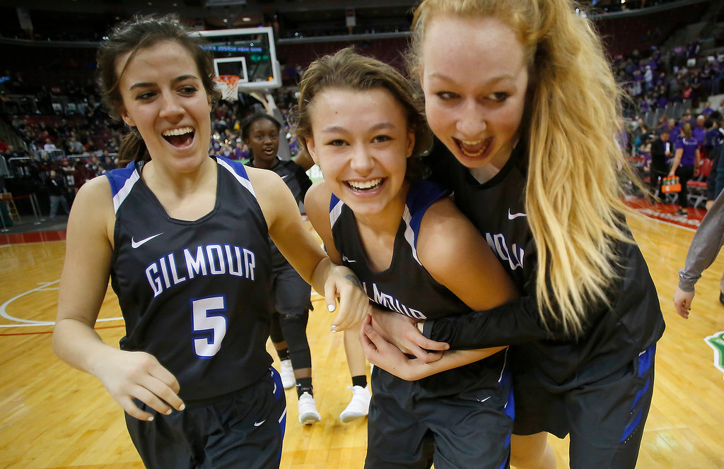 . Gilmour Academy teammates (from left) jordan Nolan(5), Athena However(30) and Liz Bender (right) celebrate the narrow win over Bellbrook following action in the OHSAA division II state semi-final at Valu City Arena, Columbus.  The Lancers will take on Toledo Rogers for the state championship on Saturday.  (Photo By Joe Maiorana/ImpactActionPhotos.com)