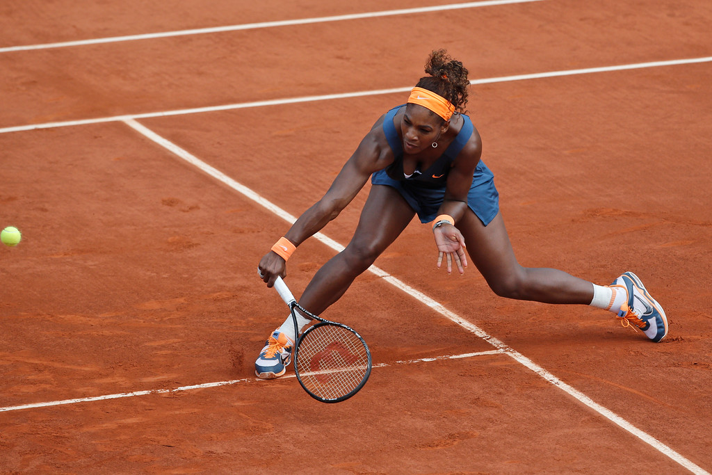 . Serena Williams of the U.S. returns against Russia\'s Maria Sharapova in the women\'s final of the French Open tennis tournament, at Roland Garros stadium in Paris, Saturday June 8, 2013. (AP Photo/Christophe Ena)