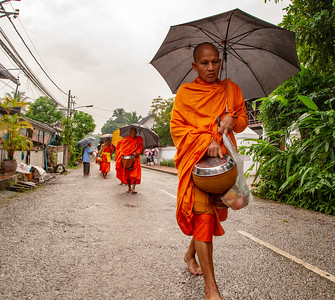 Buddhist Monks Gathering Alms in Luang Prabang, Laos