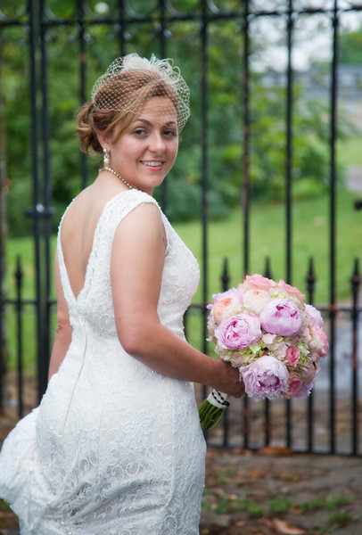 Bride in front of gate.jpg