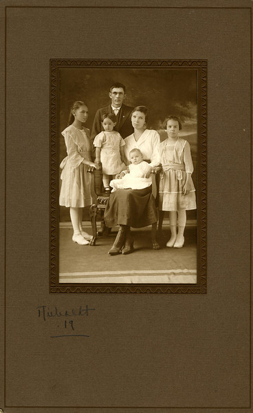 Sanford Clark family: Sanford, Lucille, Amelia, Eva (holding Clifford) and Helen (Lucille and Helen were Sanford's children from his first marriage, to Edith Tollefson. Edith died soon after giving birth to their son Sanford, who also died)