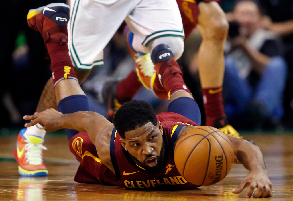 . Cleveland Cavaliers center Tristan Thompson dives for the ball during the first half of Game 1 of the NBA basketball Eastern Conference Finals against the Boston Celtics, Sunday, May 13, 2018, in Boston. (AP Photo/Michael Dwyer)