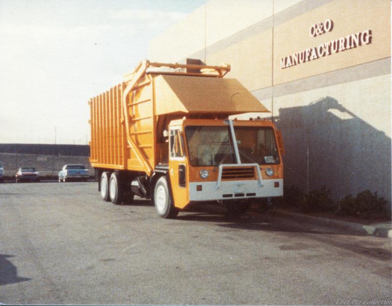 Crane Carrier Partial Pack Front Loader