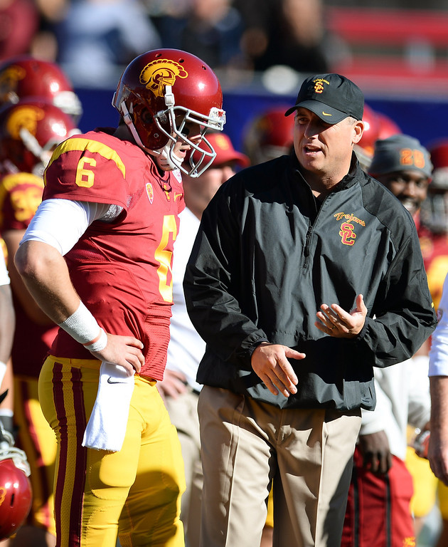 . LAS VEGAS, NV - DECEMBER 21:  Quarterback Cody Kessler #6 of the USC Trojans talks to interim coach Clay Helton before playing the Fresno State Bulldogs in the Royal Purple Las Vegas Bowl at Sam Boyd Stadium on December 21, 2013 in Las Vegas, Nevada.  (Photo by Ethan Miller/Getty Images)