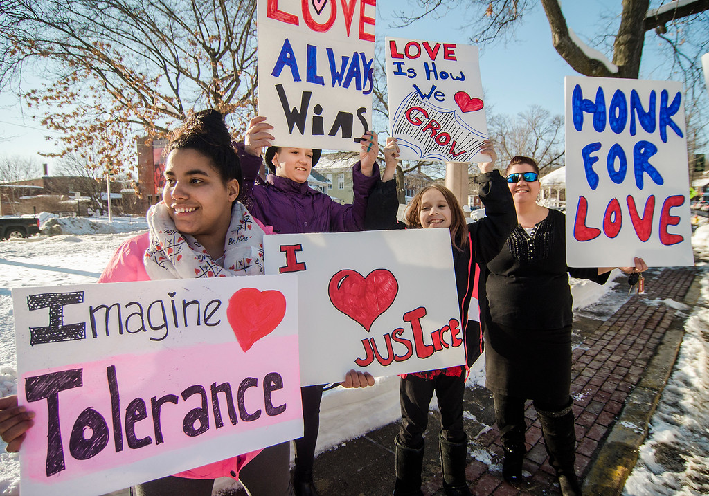 . First Parish Church of Fitchburg and Wil Darcangelo and the Tribe hosted the \'Young People\'s Walk for Love\' on the Upper Common in Fitchburg on Tuesday, February 14, 2017. Kassandra Rivera, Sierra Leary, Gabriella Procell and Leona Phaneuf hold signs during the event. SENTINEL & ENTERPRISE / Ashley Green