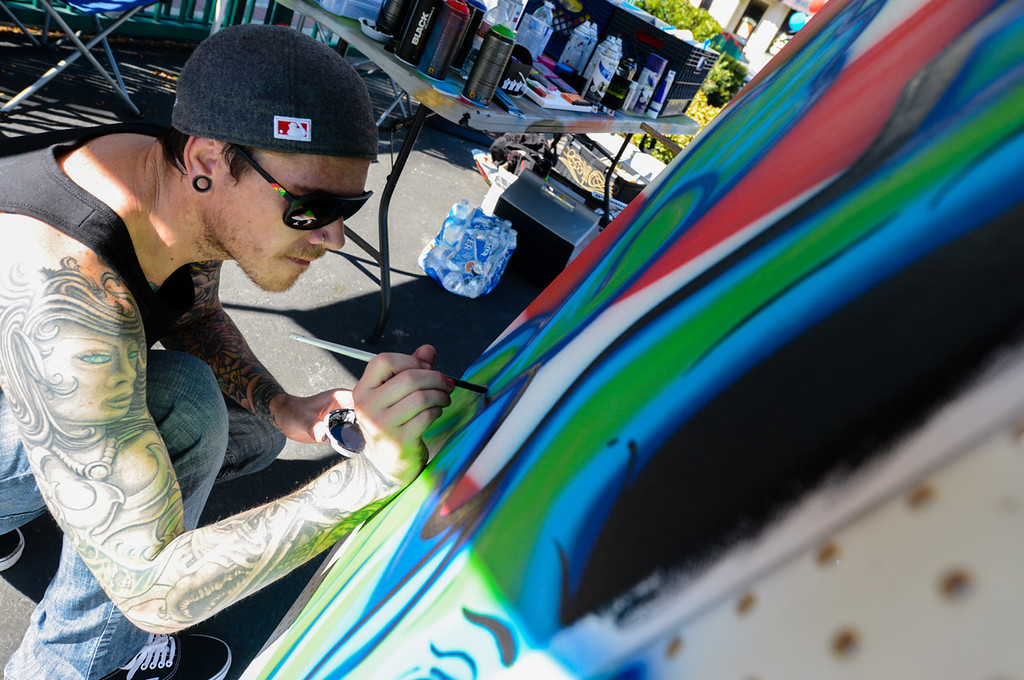. Artist Shane Hibbetts creates a painting during the Turn Up the Vote event at Court Street Square in San Bernardino on Sunday, Oct. 20, 2013. Zealous Creative and San Bernardino Generation Now hosted the event in effort to encourage young adults to participate in the November 5 election. (Rachel Luna / San Bernardino Sun)