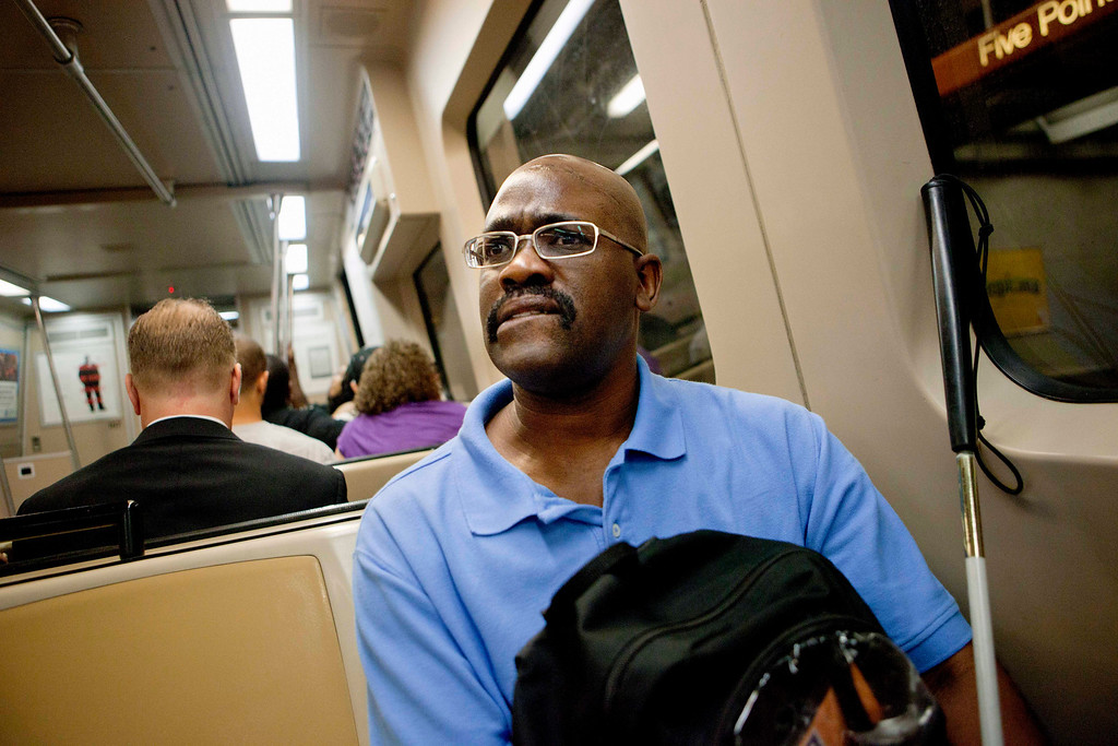 """. Jimmie Burnette, who lost his vision to a brain tumor in 2010, rides the subway while practicing taking public transportation by himself in Atlanta on June 20, 2012. \""""At times, it\'s almost like total dark, it\'s gloomy. But I have to find things to lighten up my darkness.\"""" (AP Photo/David Goldman)"""