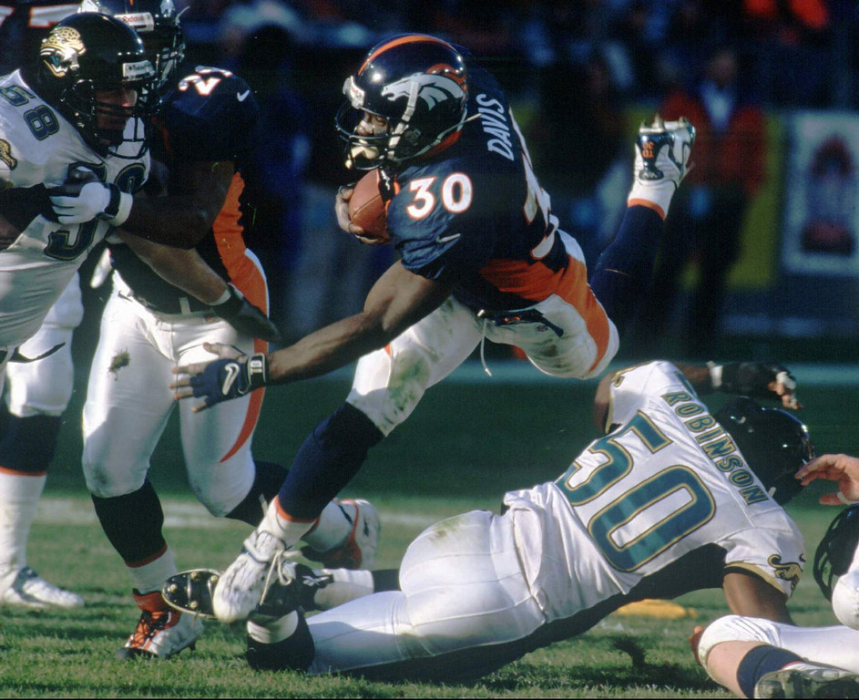 . Denver compiled 310 rushing yards and 511 total yards of offense in a 42-17 win, and avenged their playoff loss to the Jaguars the year before.  Denver running back Terrell Davis (#30) jumps over Jacksonville linebacker Eddie Robinson (#50) in the second quarter of Saturday\'s AFC Wildcard playoff game in Denver. Davis rushed for 184 yards and two touchdowns on the day to help the Broncos beat the Jaguars 42-17. PHOTOGRAPH BY JERILEE BENNETT/COLORADO SPRINGS GAZETTE
