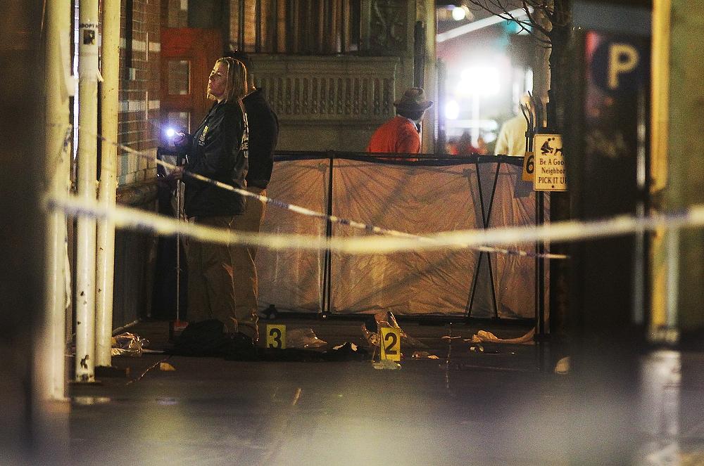 . Police investigate the scene of a fatal shooting on W. 58th Street in Manhattan on December 10, 2012 in New York City.  A 31-year-old man was shot in the head in the broad daylight and has since been pronounced dead.  (Photo by Mario Tama/Getty Images)