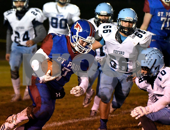 11/22/2017 Mike Orazzi | Staff St. Paul's Pedro Garcia (47) during Wednesday night's football game in Bristol.
