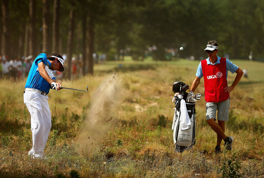 . PINEHURST, NC - JUNE 12: Bubba Watson of the United States hits an approach shot as caddie Ted Scott looks on during the first round of the 114th U.S. Open at Pinehurst Resort & Country Club, Course No. 2 on June 12, 2014 in Pinehurst, North Carolina.  (Photo by Streeter Lecka/Getty Images)