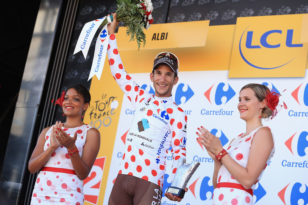 . ALBI, FRANCE - JULY 05:  Biel Kadri of France riding for AG2R-La Mondiale takes the podium after earning the king of the mountains polka dot jersey in stage seven of the 2013 Tour de France, a 205.5KM road stage from Montpellier to Albi, on July 5, 2013 in Albi, France.  (Photo by Doug Pensinger/Getty Images)