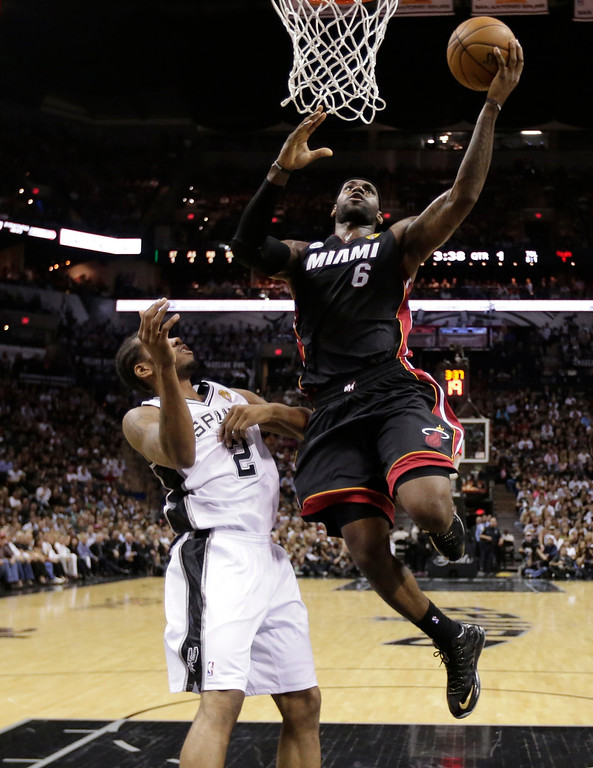 . Miami Heat\'s LeBron James (6) shoots as San Antonio Spurs\' Kawhi Leonard (2) defends during the first half at Game 4 of the NBA Finals basketball series, Thursday, June 13, 2013, in San Antonio. (AP Photo/Eric Gay, Pool)