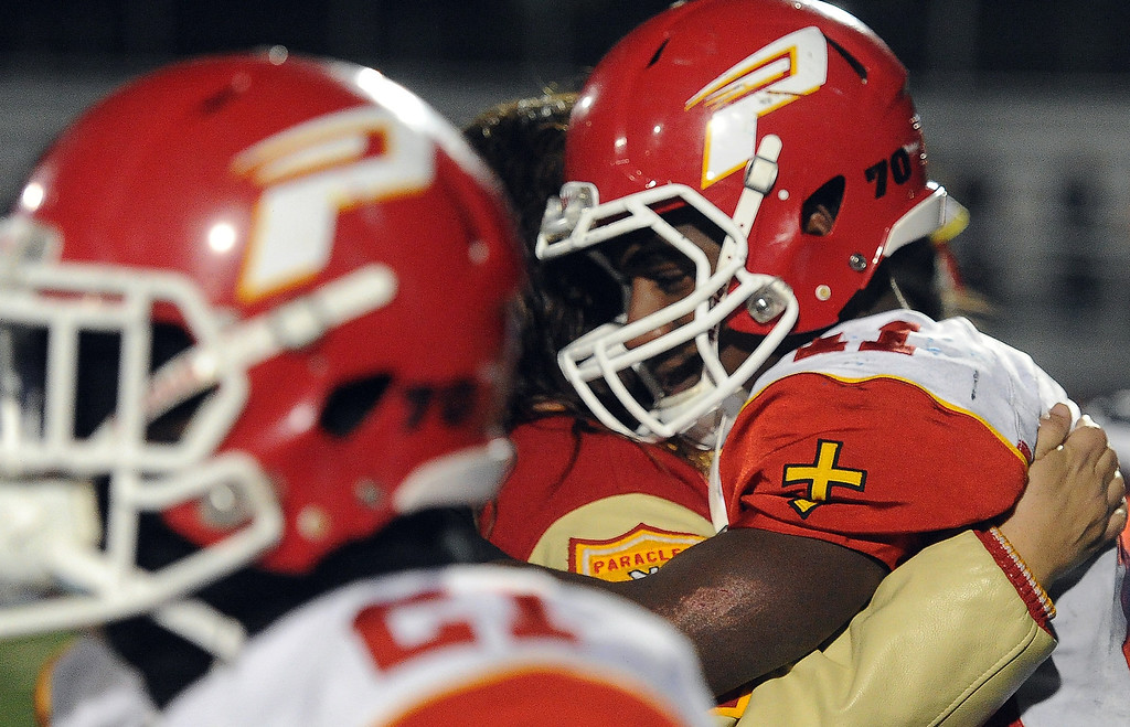 . Paraclete\'s Melquise Stovall, right, is consoled after losing to San Dimas 20-14 a CIF-SS Mid-Valley Division championship football game at San Dimas High School in San Dimas, Calif., on Friday, Dec. 6, 2013.   (Keith Birmingham Pasadena Star-News)