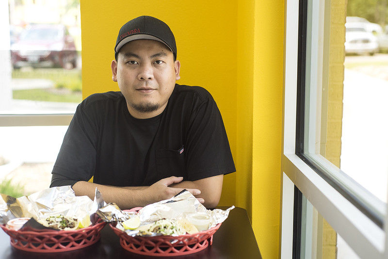 Chef Chandra Fnu poses for a portrait with tacos he made at UT Donuts & Tacos in Tyler, Texas, on Wednesday, Aug. 23, 2017. The new restaurant serves donuts, kolaches, tacos, seafood and more across from The University of Texas at Tyler's campus. (Chelsea Purgahn/Tyler Morning Telegraph)