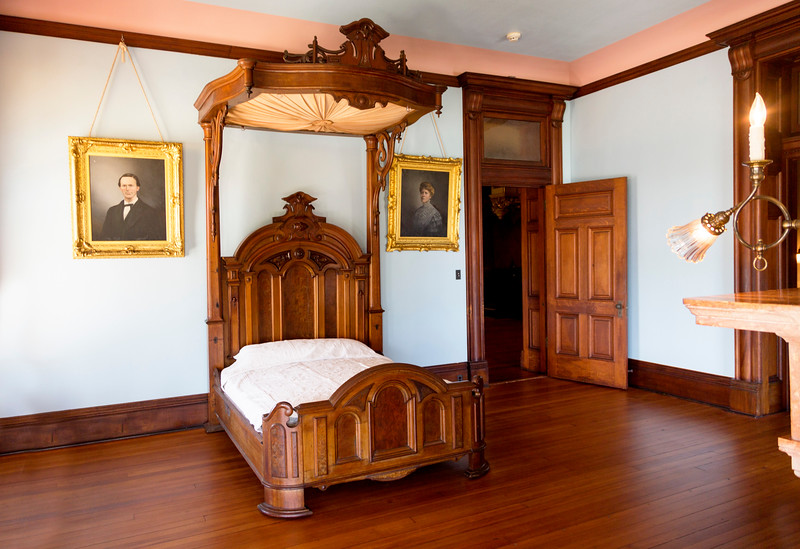 An upstairs bedroom with a covered bed.